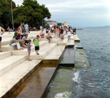 Sea Organ - The movement of the sea pushes air through, and  depending on the size and velocity of the wave create random harmonic sounds