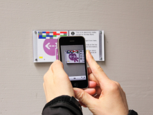 Sensor plaques are scanned using a smart phone to access additional data not provided physically.