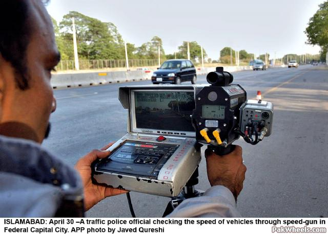 A Pakistan Motorway Police Officer measuring the speed of vehicles