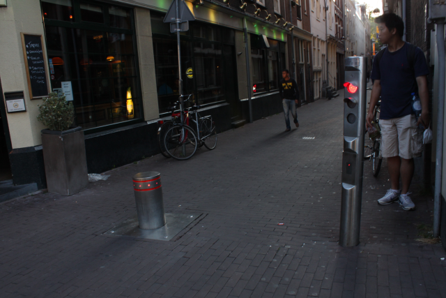 Bollard in Amsterdam. It identifies electronic tag in car, so it opens when enrolled car try to enter to special str.(pedestrian str.)