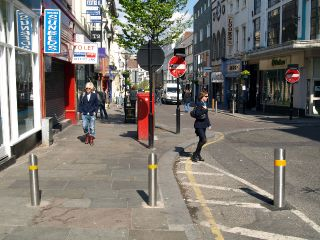 Liverpool's Bold Street is pedestrian, but allows some traffic. These bollards are motion activated and allow passage at certain times.