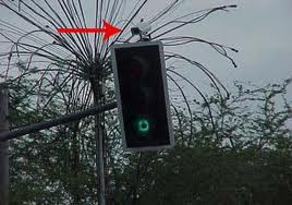 sensor for the traffic light with green light on the plate