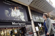 "Screen advertisements in Paris, France<br/><br/>Photo credit: http://img.timeinc.n<wbr/><span class=""wbr""></span>et/time/daily/2009/0<wbr/><span class=""wbr""></span>904/360_france_smoke<wbr/><span class=""wbr""></span>_alt_0423.jpg"