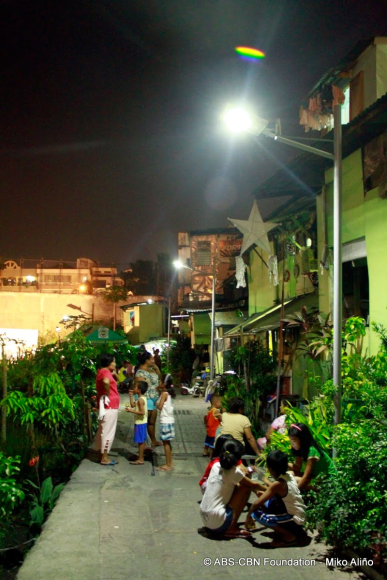 solar streetlights in poor areas of the city.