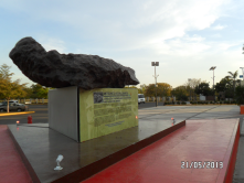 A meteor in exhibition in Science Park in Culiacan and in the bottom the solar panels for the public ilumination in the parking area.