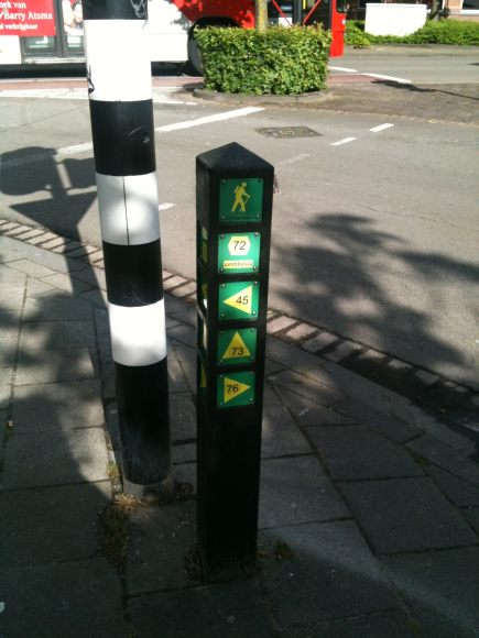Not fancy technology, but it provides indication for pedestrians if they want to follow certain routes.