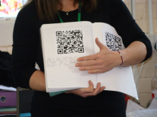 Textbook with QR-codes.