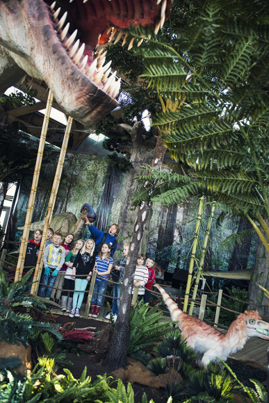 Universeum, Sweden - children interact with mechanical dinosaurs, learning about these ancient reptiles