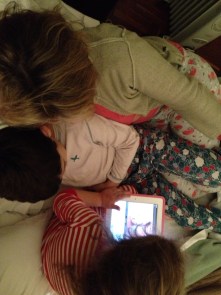 Little 4 y old girl showing rest of family a video of Hello Kitty @ Youtube on an iPad