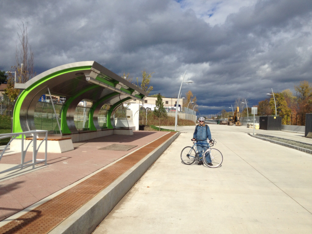 Cyclist on CTFasTrack guideway in Elmwood, hoping for the day that the bike trail alongside will run to Hartford!