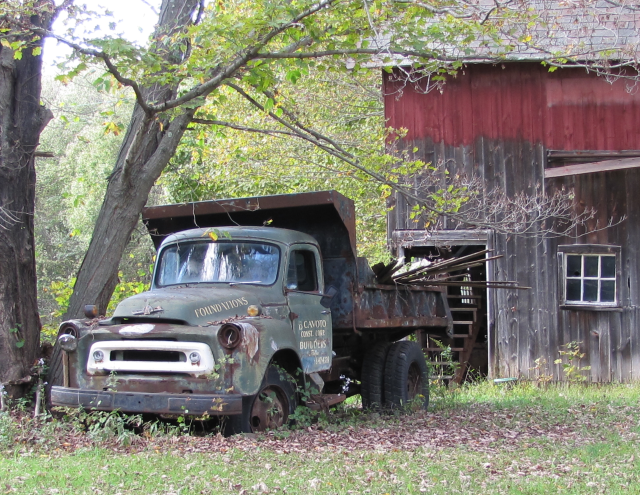 An old truck and barn in Monroe, Connecticut.
