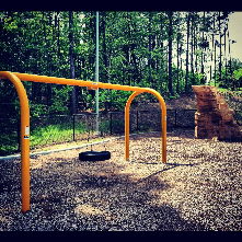 Bethesda tot lot has a nice tire swing, climbing struce and a few otherfeatures such as musical instruments (not pictured)