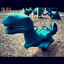 T- Rex playground rocker at Campus Hills