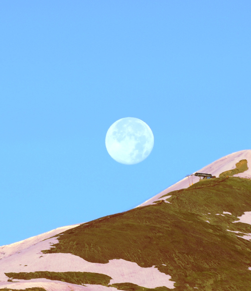 A full moon over Peak 8