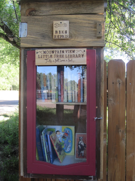 The Little Free Library at Vine and Overland...bikers and walkers can leave a book and take a book - or, fix their bike!