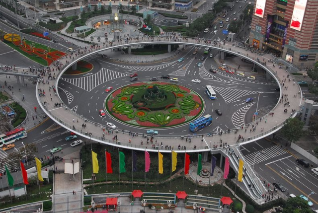 Pedestrian roundabout in Shanghai (http://bit.ly/lujiazui). It can function as a walking trail or viewing deck as well.