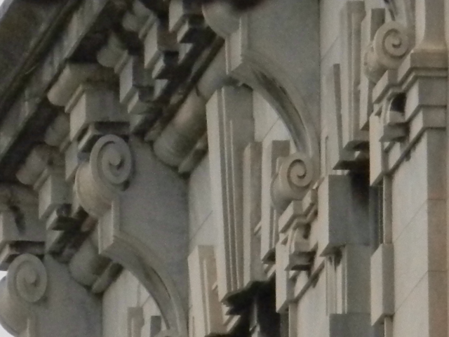 It truly captivated me.  The details of some of our historic buildings' upper levels should be played up, not down.