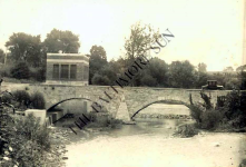 The old bridge  that was next to the old power plant. The dam is on the otherside and it shows a Model T driving across