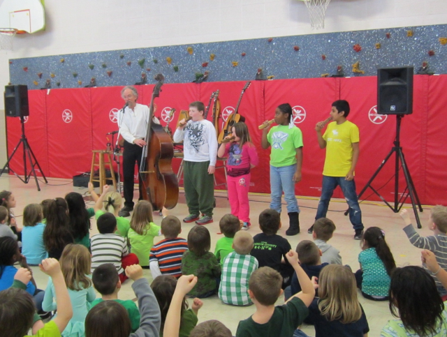"""Les Gustafson-Zook from Indiana came to Hills Elementary to present """"Songs of the Pioneers""""."""
