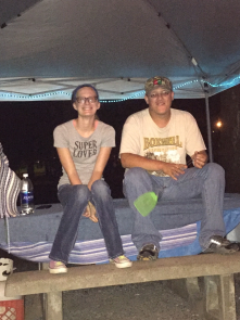 Jason & Kayla sitting on a picnic table at Hillman's Ferry Campground