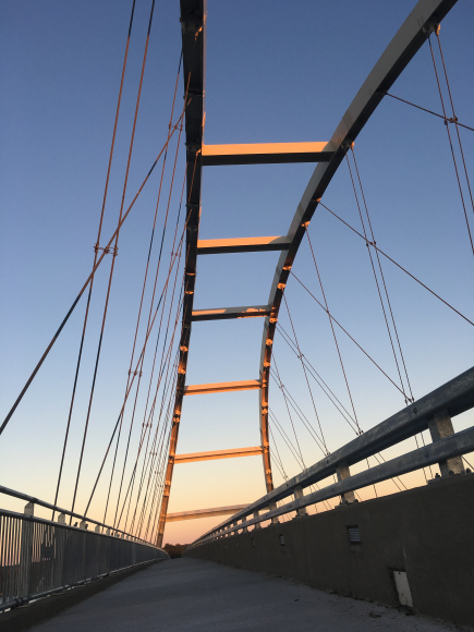 Sunrise coming up over the bridge.