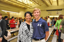 Mrs. Martin, the beloved counselor at Andersen Middle School, with Wolf Lucas at 8th Grade Recognition Night.