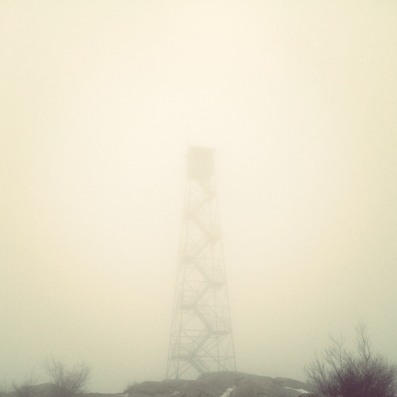 Foggy fire tower atop Mt Beacon