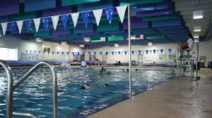 Fitness & Aquatics Center. Indoor pool. Gym with walking track above. Weight Room. CHILD CARE