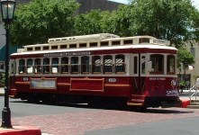 Vintage looking trolly to ride around on and take people to and from nearby neighborhood stops.