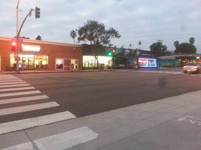 Safe Intersection for Crossing Lincoln: well lit with a traffic signal and clear pedestrian walkways.